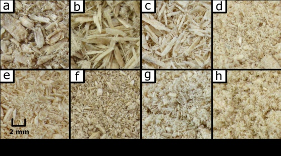 Photographs of ground wood chips after treatment